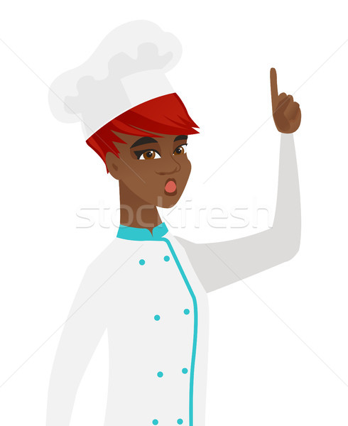 African chef with open mouth pointing finger up. Stock photo © RAStudio