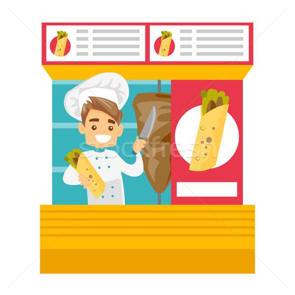Caucasian white chef preparing shaurma in a kiosk. Stock photo © RAStudio