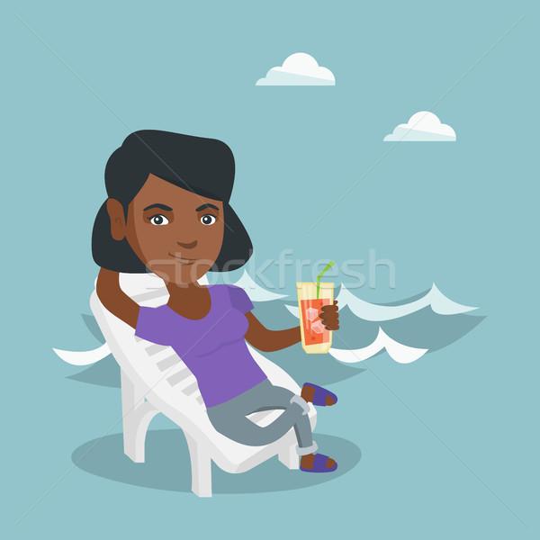 женщину расслабляющая молодые сидят пляж счастливым Сток-фото © RAStudio