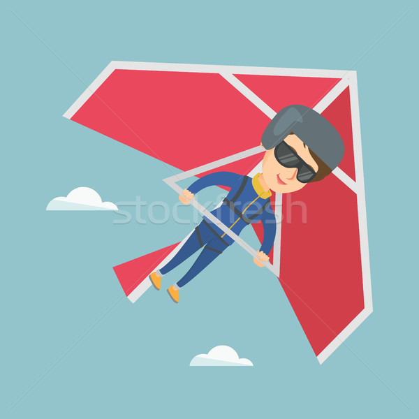Young caucasian woman flying on hang-glider. Stock photo © RAStudio