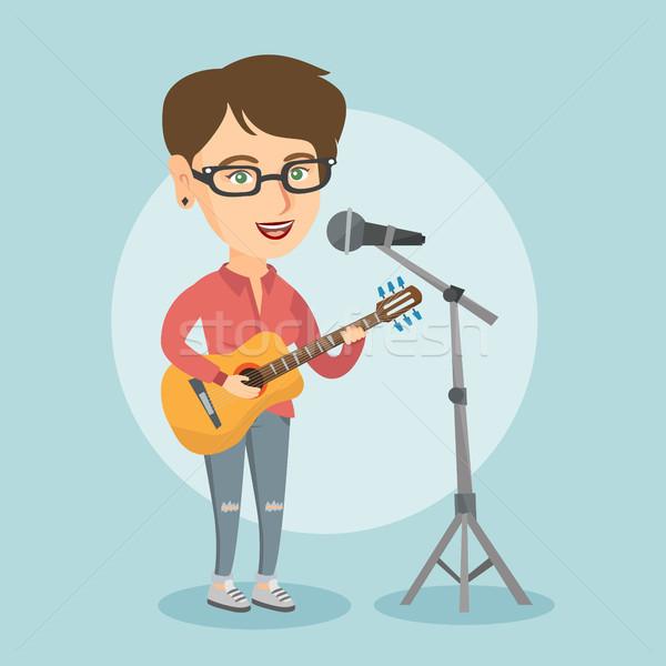 女性 歌 演奏 ギター 小さな 白人 ストックフォト © RAStudio
