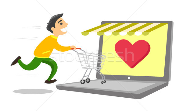 Young caucasian white man shopping online. Stock photo © RAStudio