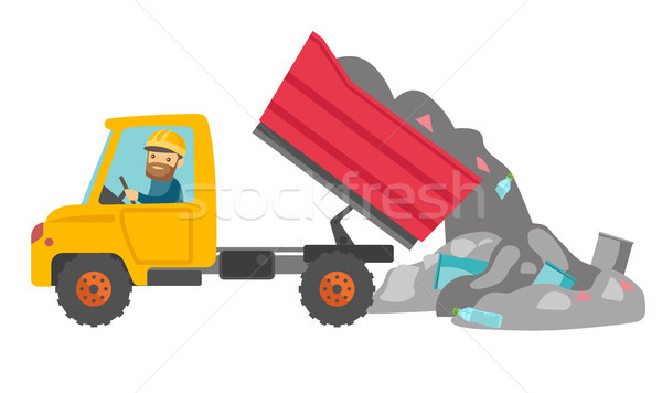 Worker and bulldozer at rubbish dump. Stock photo © RAStudio