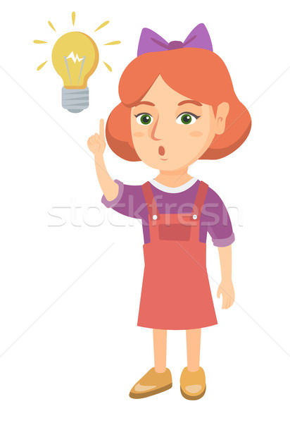 Caucasian little girl pointing at the lightbulb. Stock photo © RAStudio
