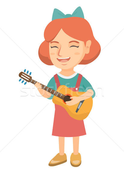 Caucasian girl singing and playing acoustic guitar Stock photo © RAStudio