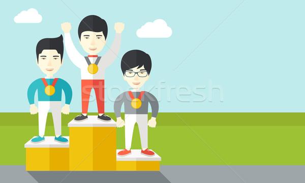 Cheerful winners on pedestal. Stock photo © RAStudio