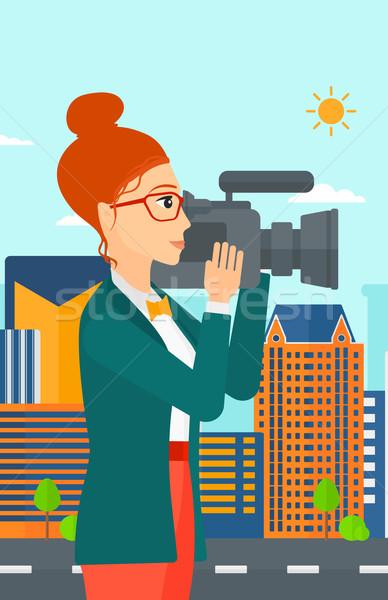 Camerawoman with video camera. Stock photo © RAStudio