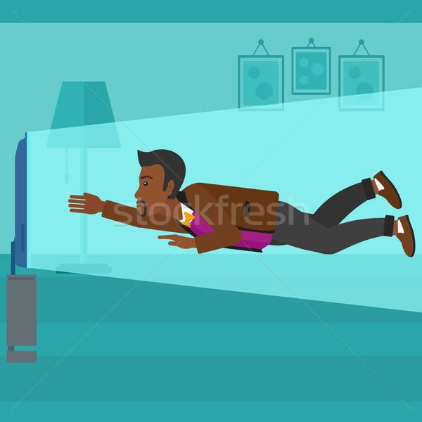 Man suffering from TV addiction. Stock photo © RAStudio