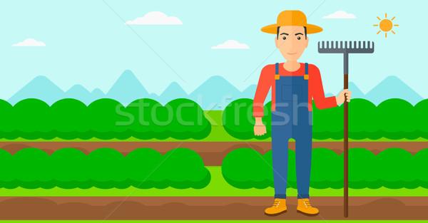 фермер грабли человека Постоянный области Сток-фото © RAStudio