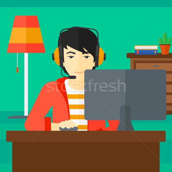 Homme jouer jeu vidéo asian casque séance Photo stock © RAStudio