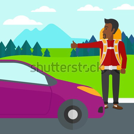 Young man hitchhiking. Stock photo © RAStudio