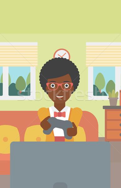 женщину играет видеоигра восторженный сидят диван Сток-фото © RAStudio