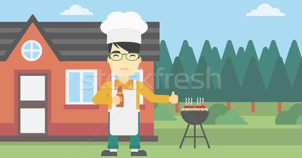 Férfi főzés hús benzin barbecue grill ázsiai Stock fotó © RAStudio