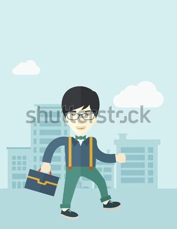 Férfi ül bőrönd vasútállomás ázsiai fiatalember Stock fotó © RAStudio