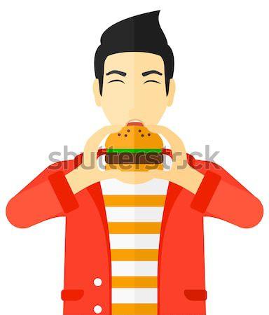 Stockfoto: Man · eten · hamburger · eten
