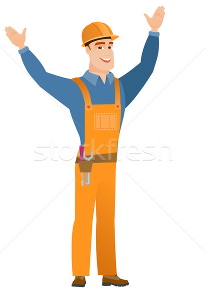 Constructor standing with raised arms up. Stock photo © RAStudio