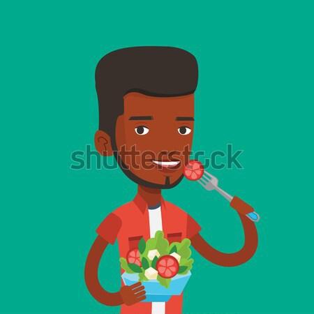 Uomo mangiare sano vegetali insalata Foto d'archivio © RAStudio