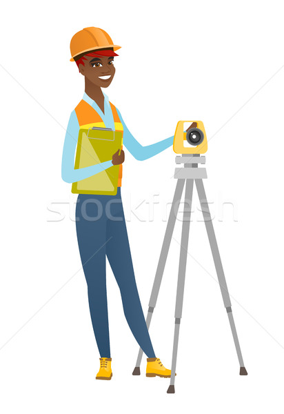African surveyor builder working with theodolite. Stock photo © RAStudio