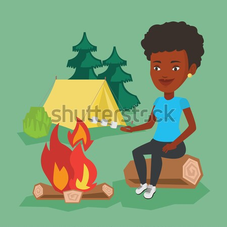 Man roasting marshmallow over campfire. Stock photo © RAStudio