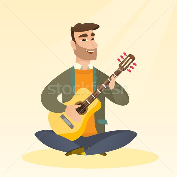 человека играет кавказский музыканта сидят Сток-фото © RAStudio