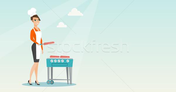 Femme cuisson steak barbecue gaz Photo stock © RAStudio