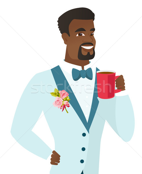 Young african-american groom holding cup of coffee Stock photo © RAStudio