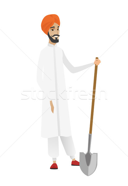 Young hindu farmer holding a shovel. Stock photo © RAStudio