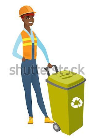Young hindu builder pushing recycle bin. Stock photo © RAStudio