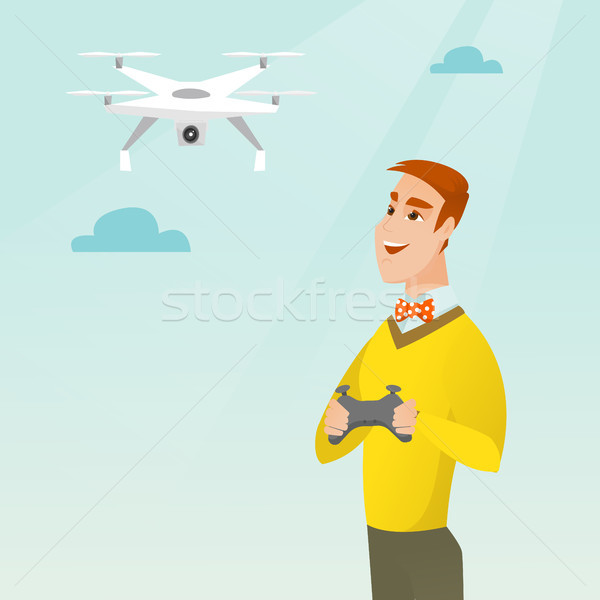 Young caucasian man flying drone. Stock photo © RAStudio