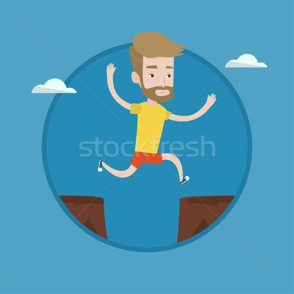 Sportsman jumping over cliff vector illustration. Stock photo © RAStudio