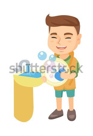 Little caucasian boy washing dishes in the sink. Stock photo © RAStudio