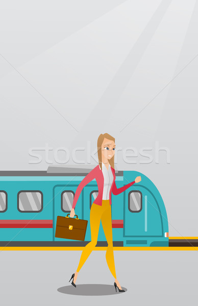 Young woman walking on a railway station platform. Stock photo © RAStudio