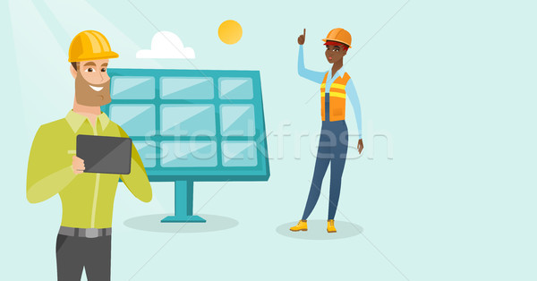 Multiethnic engineers working at solar power plant Stock photo © RAStudio
