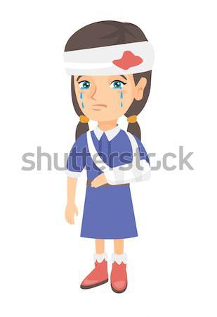 Caucasian girl with broken arm and bandaged head. Stock photo © RAStudio