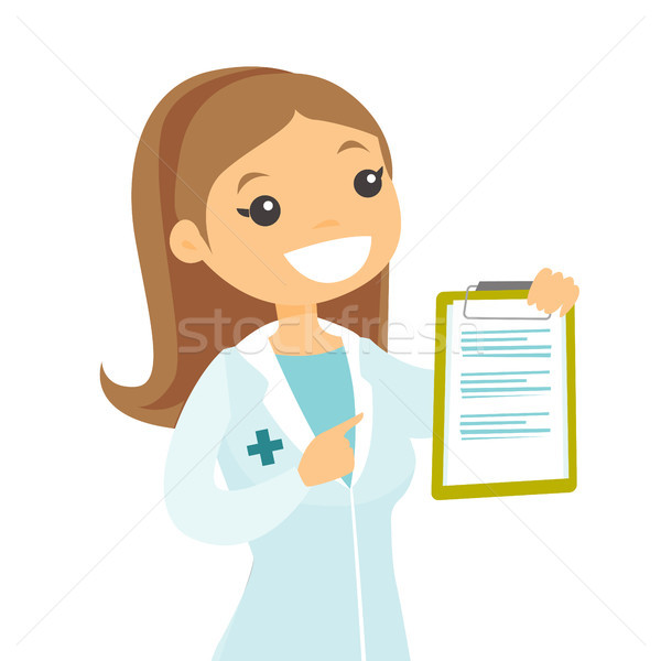 Young caucasian white doctor with a clipboard. Stock photo © RAStudio