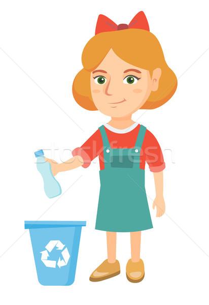 Girl throwing plastic bottle in recycle bin. Stock photo © RAStudio