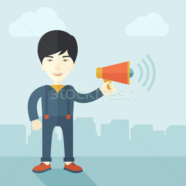 üzletember mező tart megafon kommunikál alkalmazott Stock fotó © RAStudio