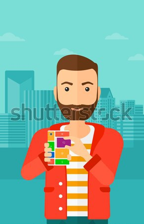Man with modular phone. Stock photo © RAStudio