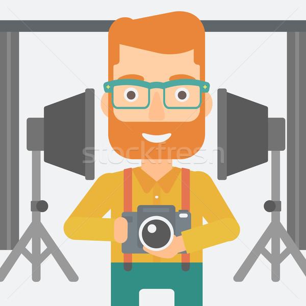Sorridente fotógrafo câmera homem Foto stock © RAStudio