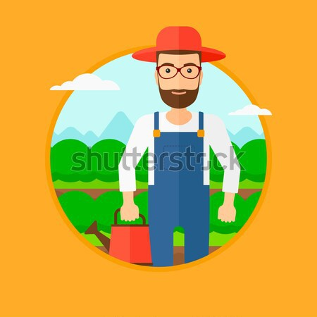 Farmer with rake at cabbage field. Stock photo © RAStudio