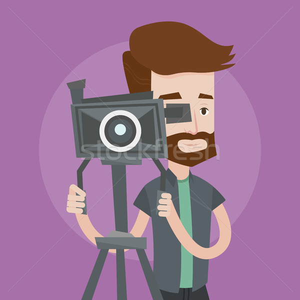 Cameraman with movie camera on tripod. Stock photo © RAStudio