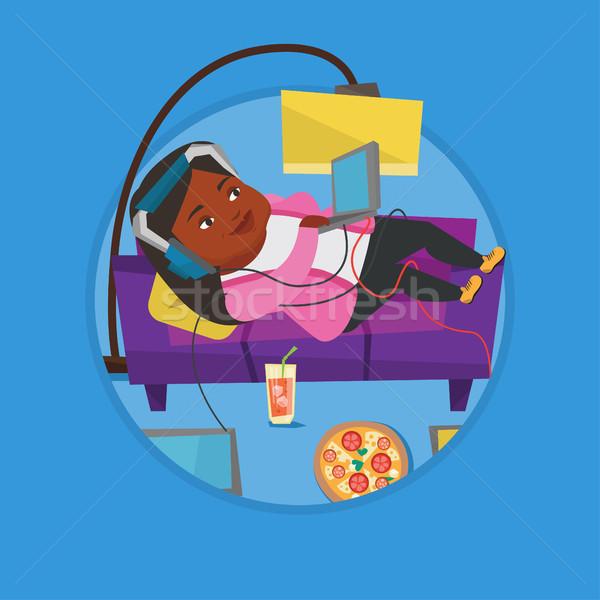 Vrouw sofa veel gadgets vet ontspannen Stockfoto © RAStudio