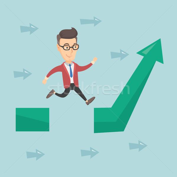 Hombre de negocios saltar brecha flecha hasta jóvenes Foto stock © RAStudio