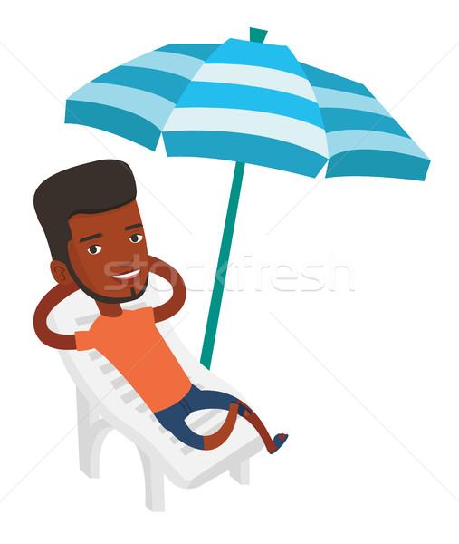 Adam rahatlatıcı şezlong Afrika oturma Stok fotoğraf © RAStudio