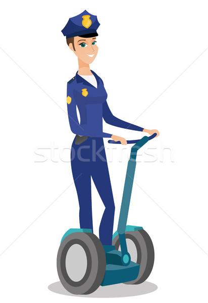 Homme équitation électrique Photo stock © RAStudio