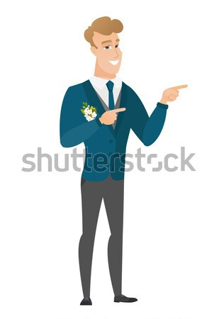 Groom with open mouth pointing finger up. Stock photo © RAStudio