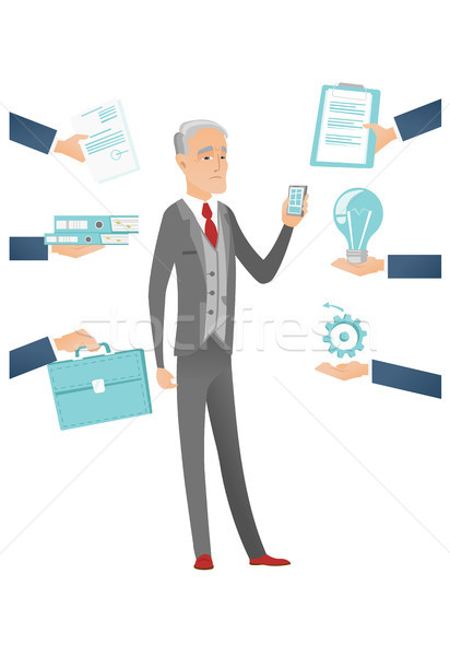 Caucasian businessman having lots of work to do. Stock photo © RAStudio
