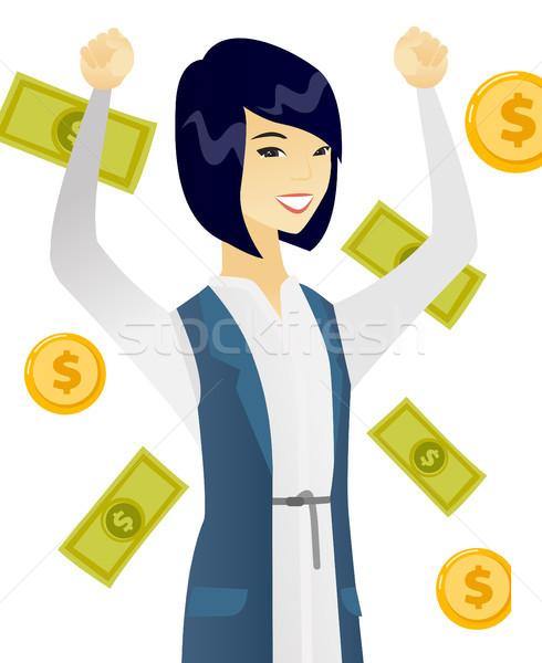 Young asian business woman under money rain. Stock photo © RAStudio