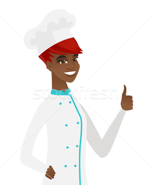 Young african-american chef giving thumb up. Stock photo © RAStudio