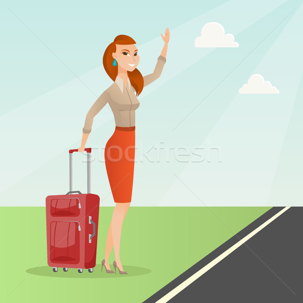 Young caucasian woman with suitcase hitchhiking. Stock photo © RAStudio
